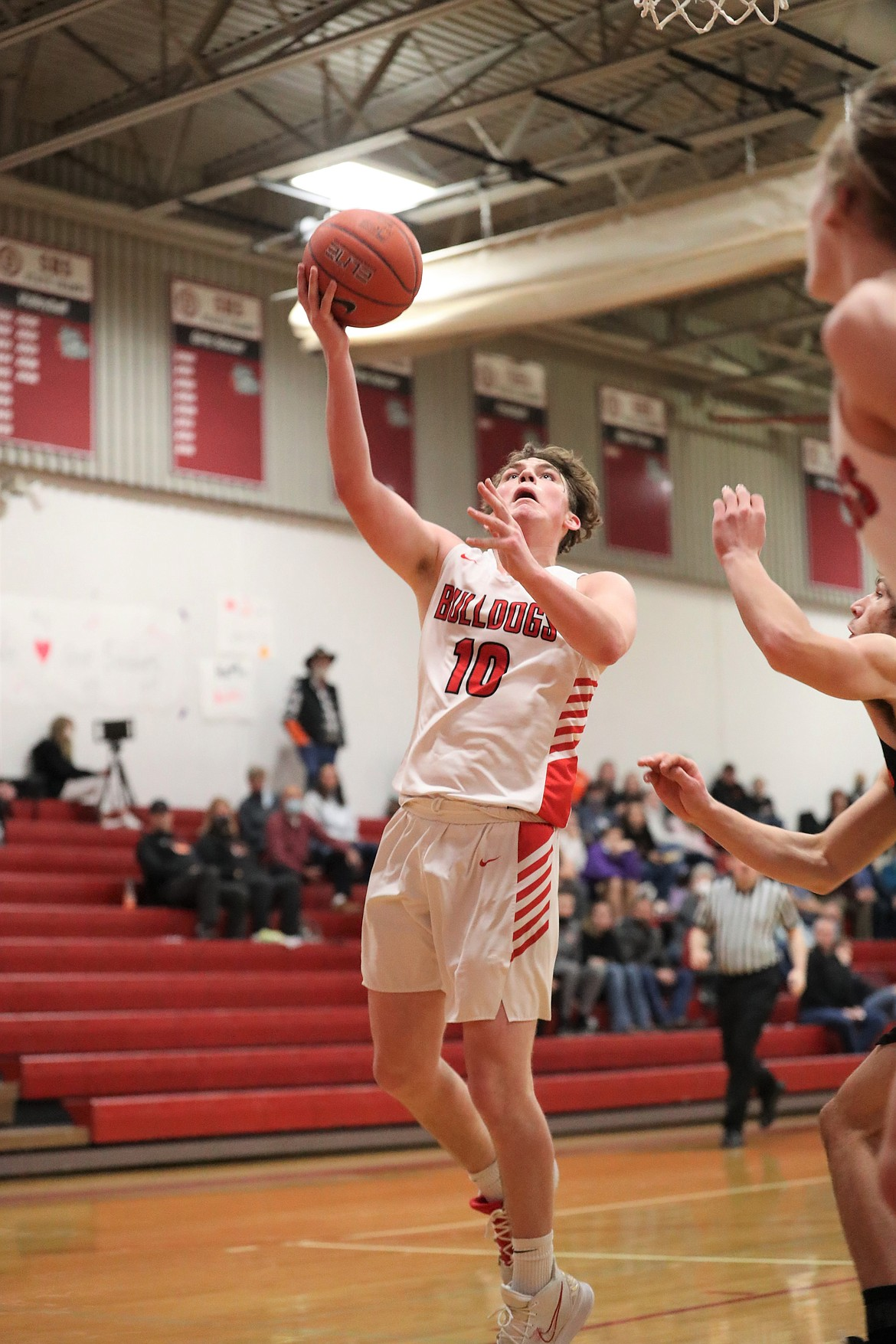 Arie VanDenBerg attempts to hit a layup during the fourth quarter of Wednesday's game.