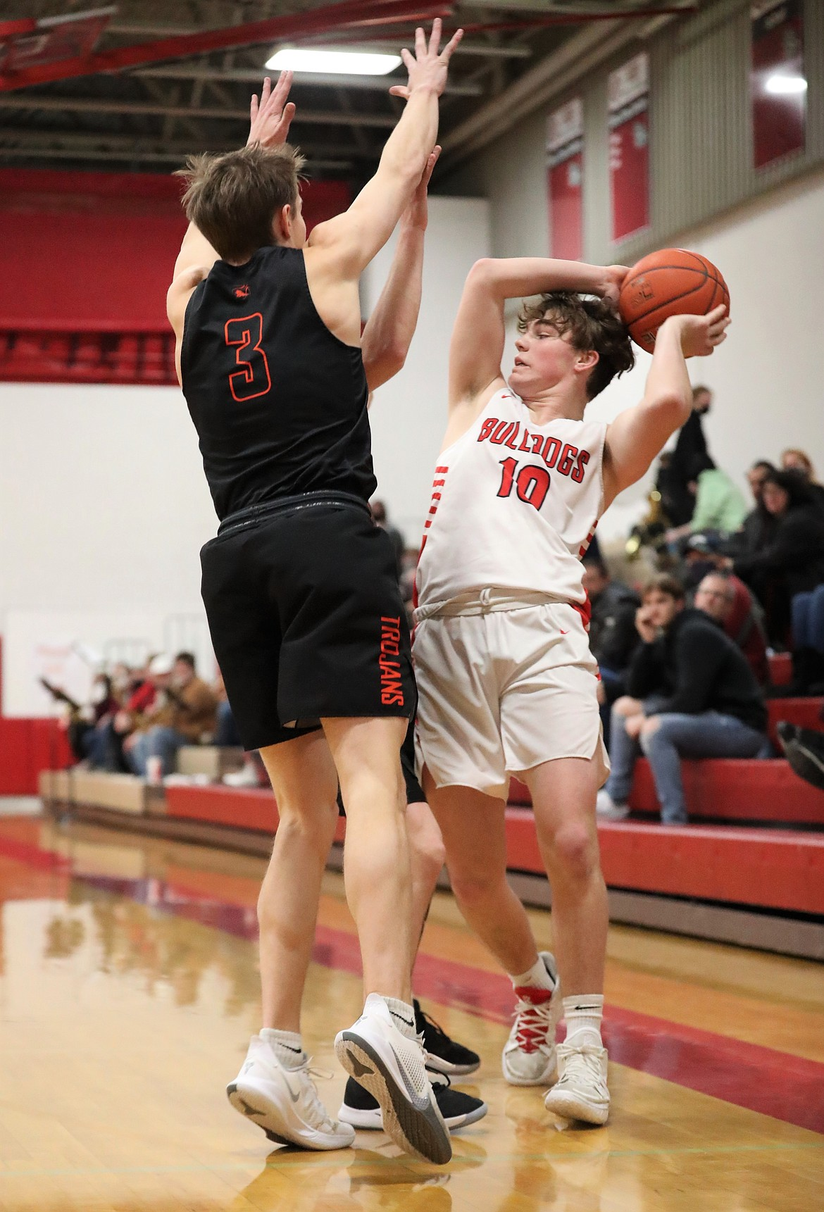 Arie VanDenBerg looks to pass the ball to an open teammate while trying to avoid stepping out of bounds on Wednesday.