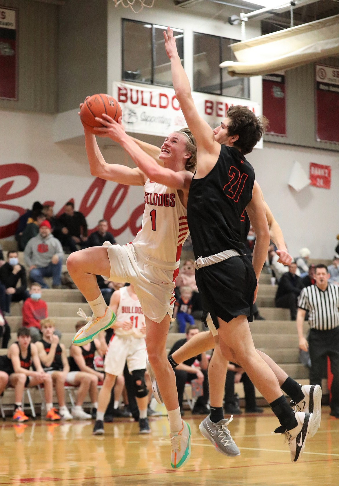 Colin Roos fights through the Post Falls defense to attempt a layup.