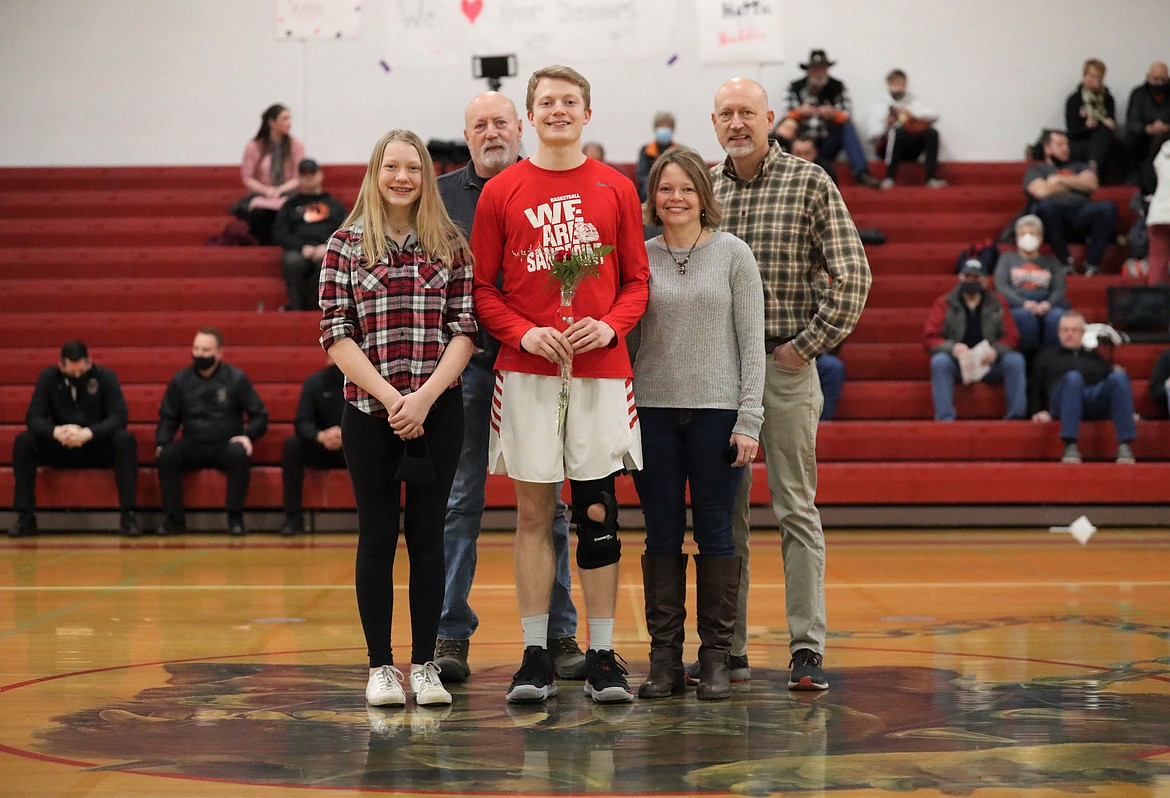 Darren Bailey poses for a photo with his family on Senior Night.