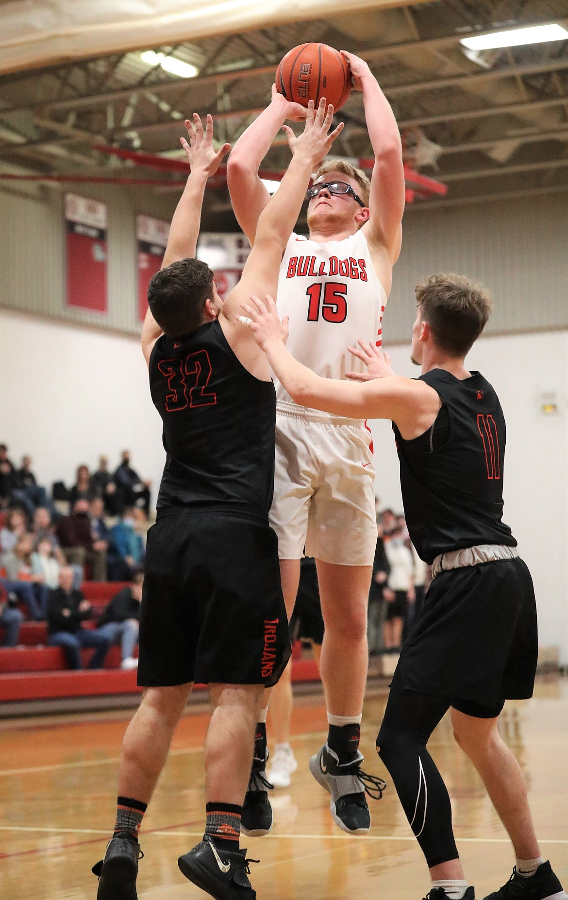 Ethan Butler elevates for a jumper over the Post Falls defense.