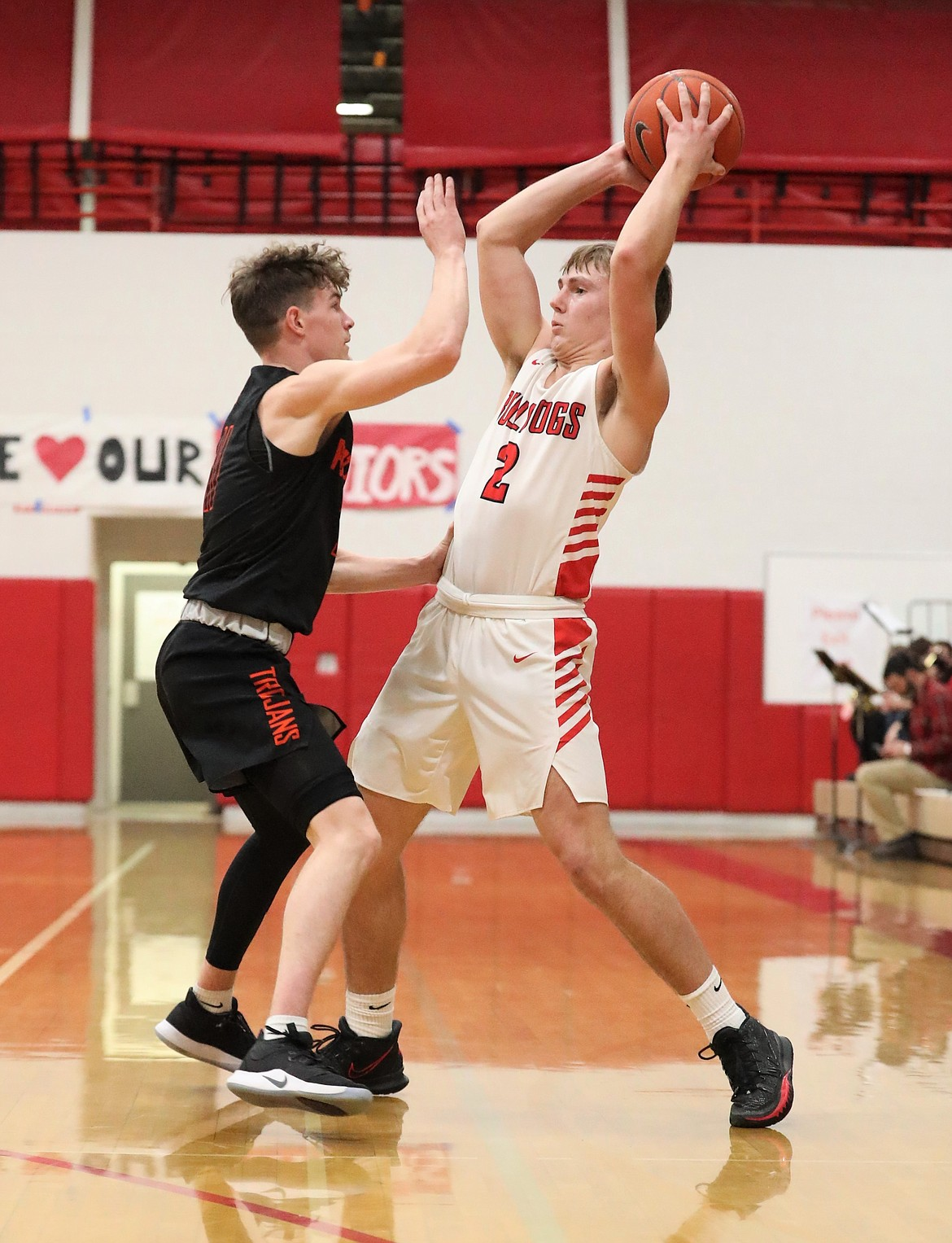 Parker Pettit prepares to fire a pass over a Post Falls defender on Wednesday.