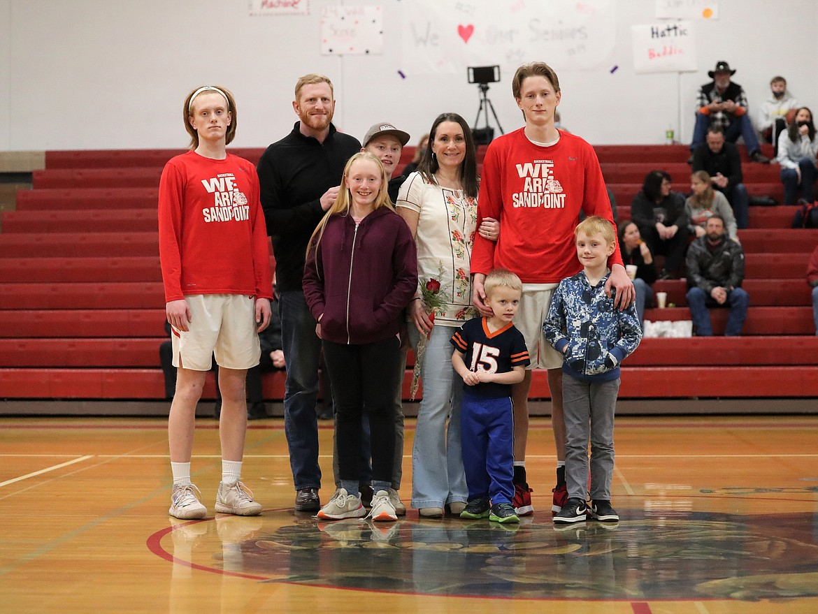 Stone Lee poses for a photo with his family on Senior Night.