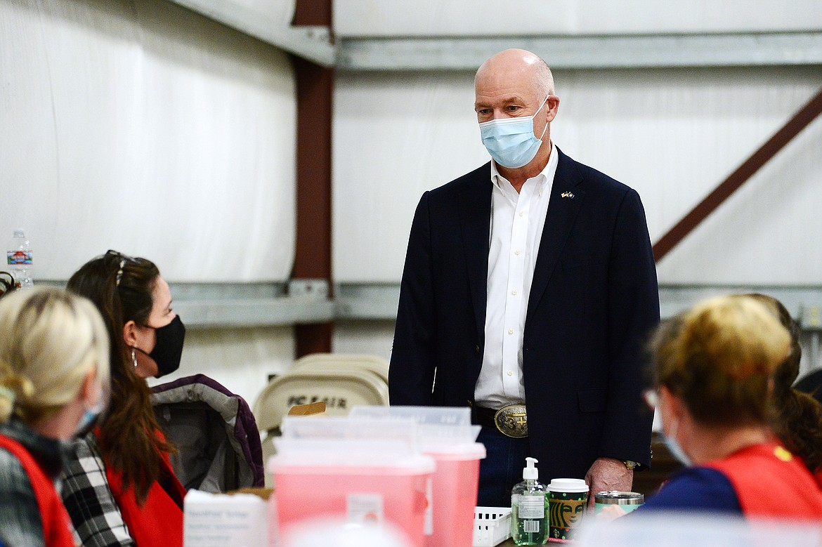 Gov. Greg Gianforte speaks with a group of nurses during a tour of a COVID-19 vaccine clinic at the Flathead County Fairgrounds in Kalispell on Friday, Feb. 12. (Casey Kreider/Daily Inter Lake)