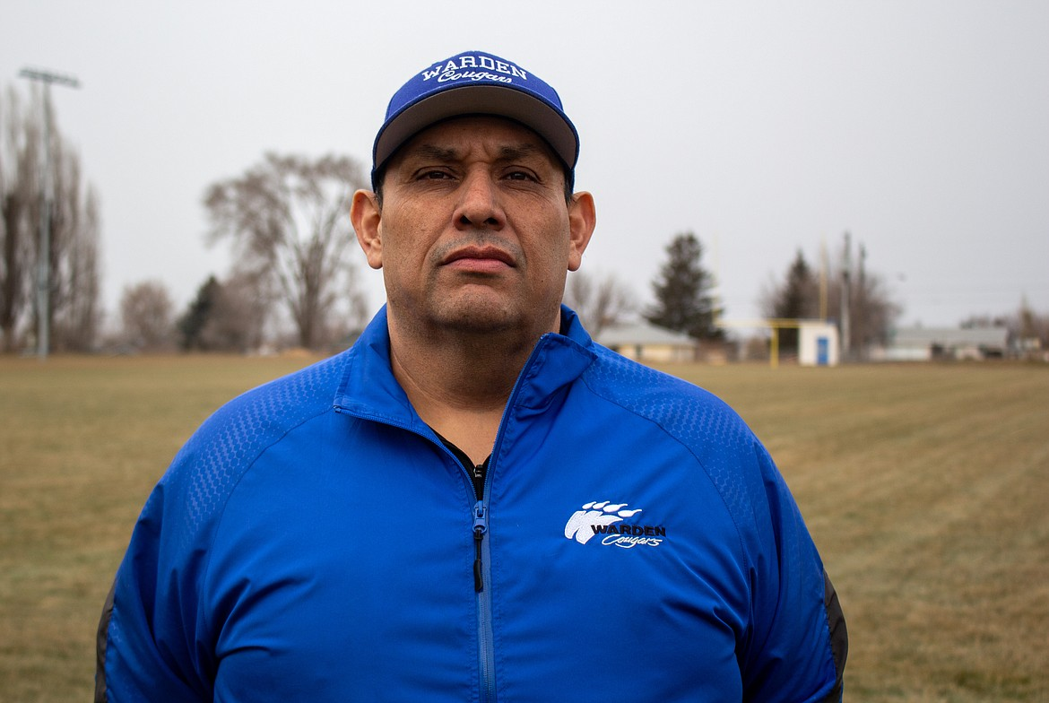Warden head football coach Robert Arredondo poses for a photo at the high school field on Friday afternoon in Warden.