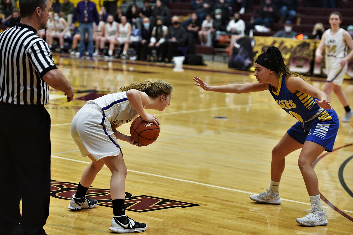 Libby's Olivia Gilliam-Smith guards Jazlyn Dalbey on Saturday. (Scot Heisel/Lake County Leader)