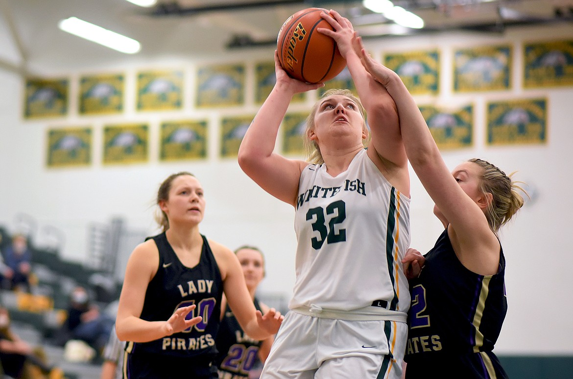 Whitefish senior Brook Smith gets fouled on her way to the hoop against Polson on Thursday. (Whitney England/Whitefish Pilot)