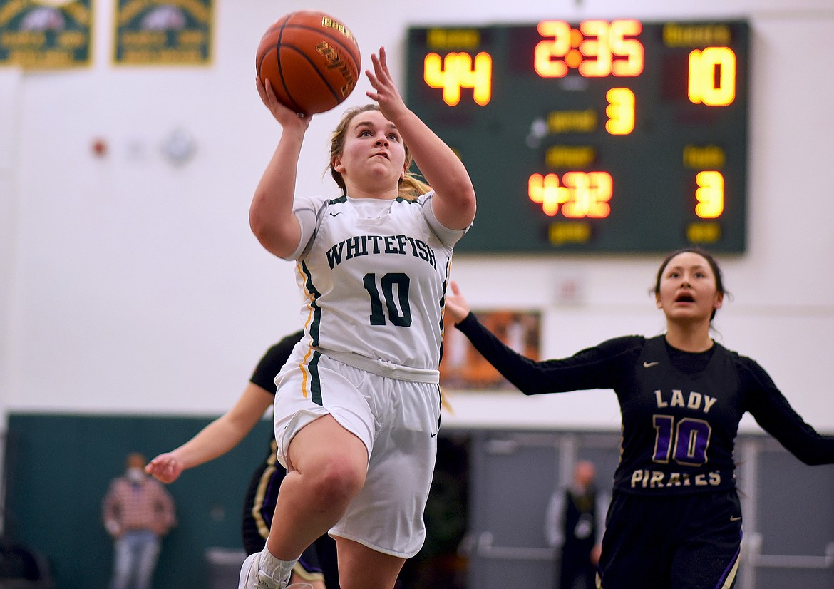 Lady Bulldog Ashton Ramsey capitalizes on a steal against Polson Thursday evening. (Whitney England/Whitefish Pilot)