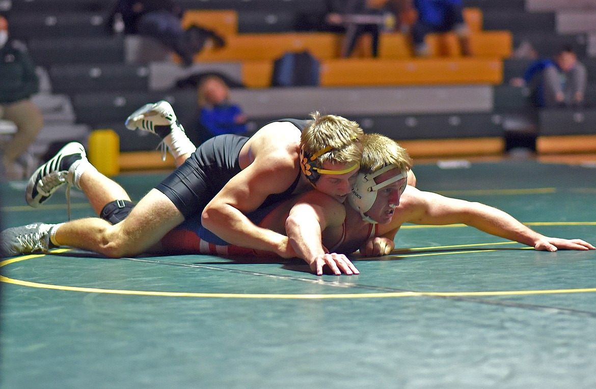 Whitefish's Camren Ross dominates over Bigfork's Joseph Ferrier on his way to a 15-1 major decision victory Friday. (Whitney England/Whitefish Pilot)