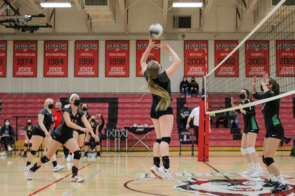 Othello's Halle Parris serves up the ball to her outside hitters during the second set of the Huskies' 3-0 win over East Valley (Spokane) on Thursday evening at Othello High School.