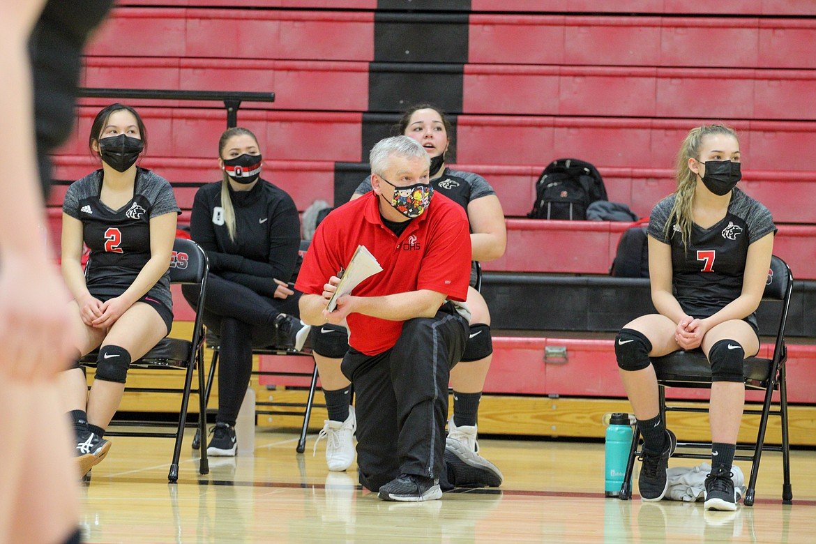 Othello Huskies head volleyball coach Steve Parris watches the match against East Valley (Spokane) from the sideline on Thursday night at Othello High School.