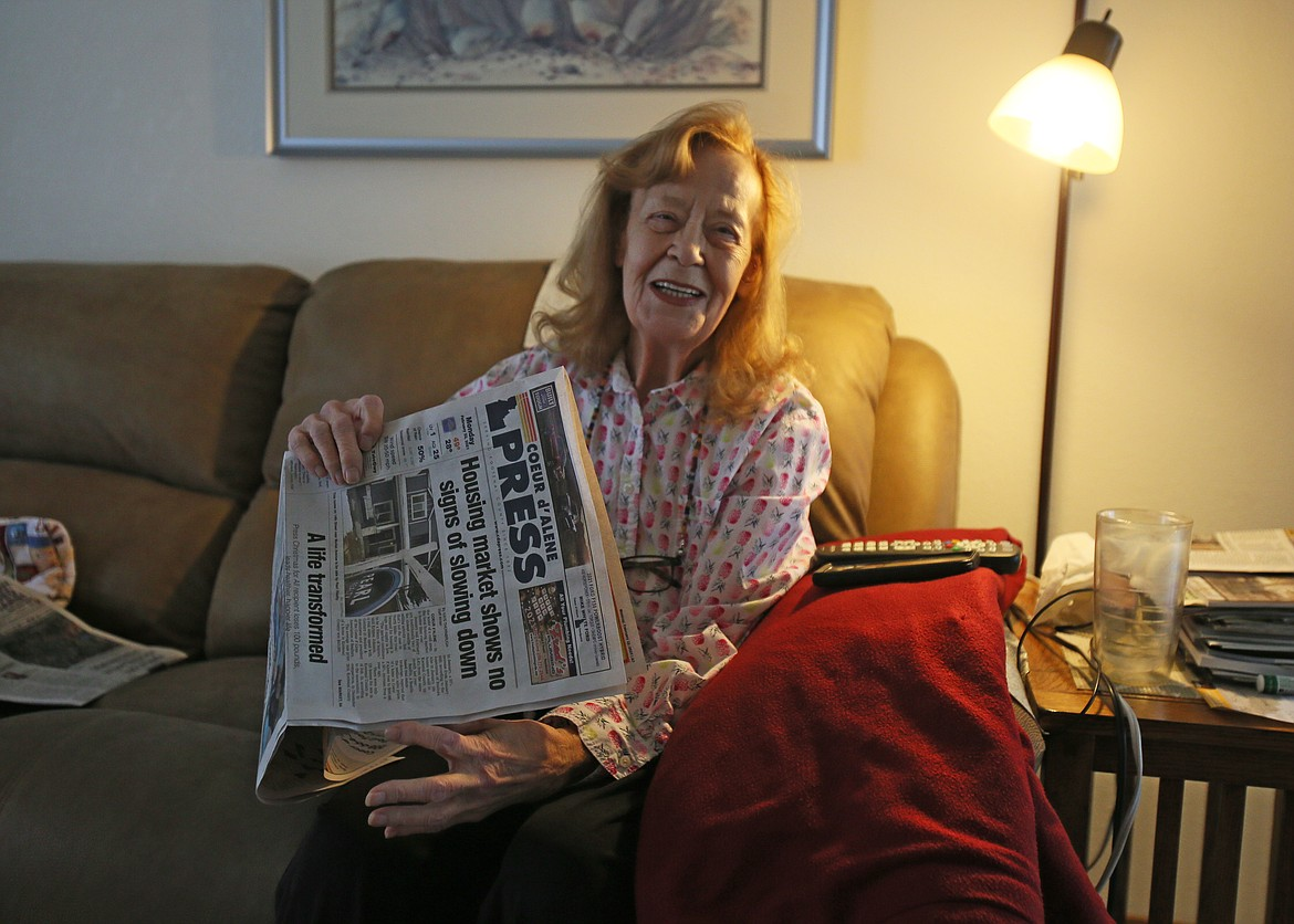Dorothy Gohl, of Coeur d'Alene, giggles as she talks about how she and the love of her life, Chuck Dempsey, who died in October, used to love reading the Ghastly Groaner in The Press. She's seen here in her home Monday.