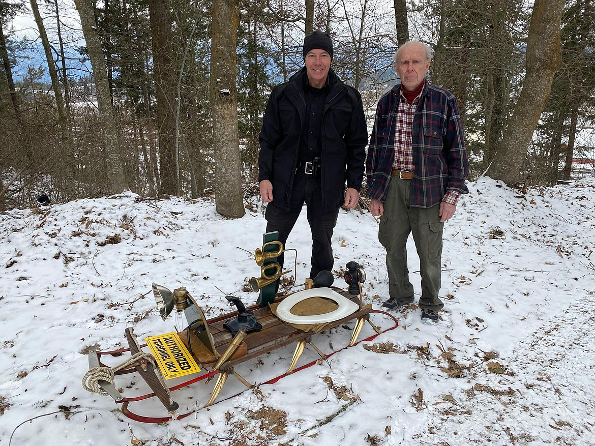 Undersheriff Richard Stephens and Ed Robbins with the sled