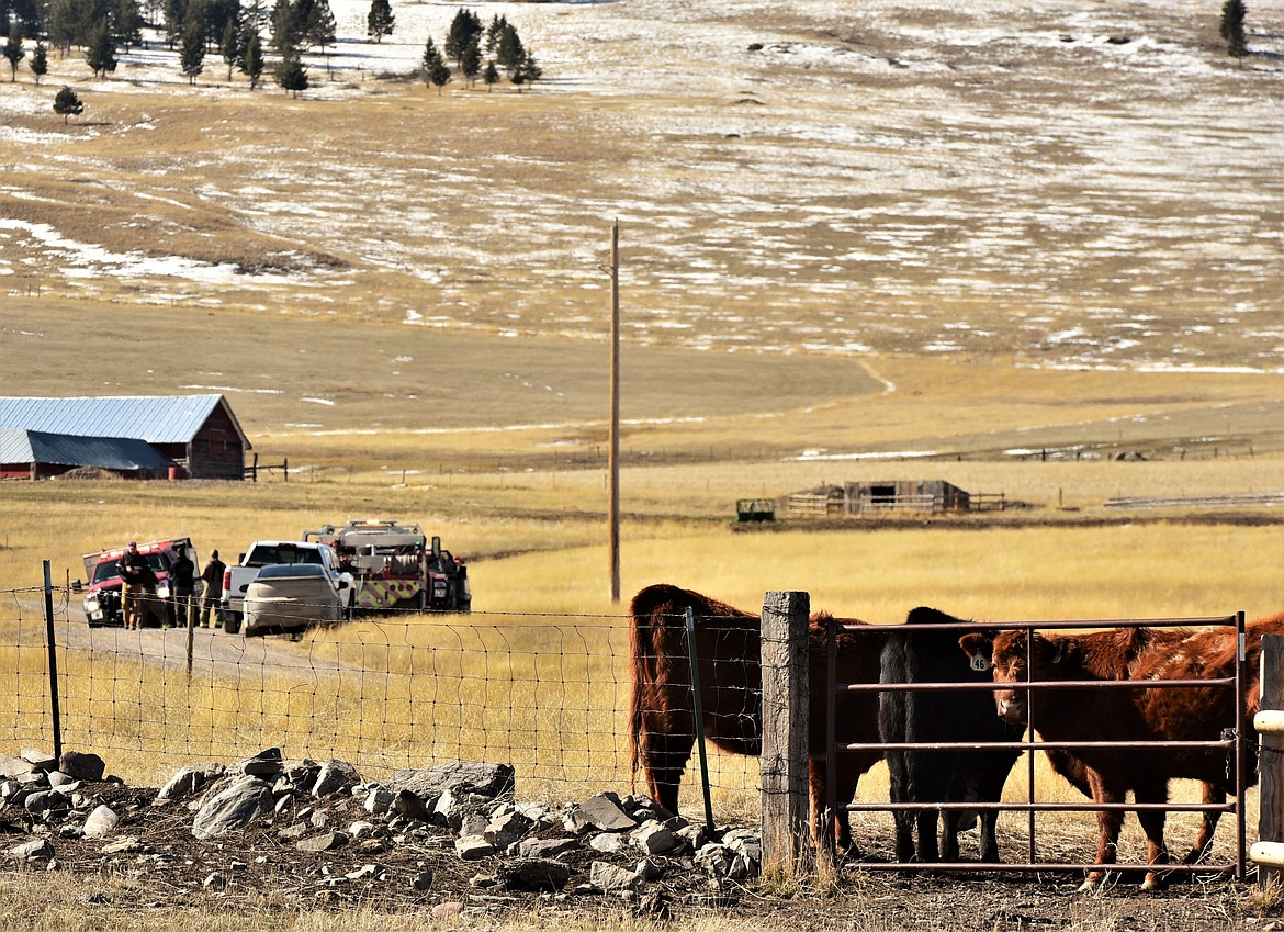 Fire and ambulance personnel set up a staging area on private ranchland just south of Irvine Flats Road on Monday. (Scot Heisel/Lake County Leader)