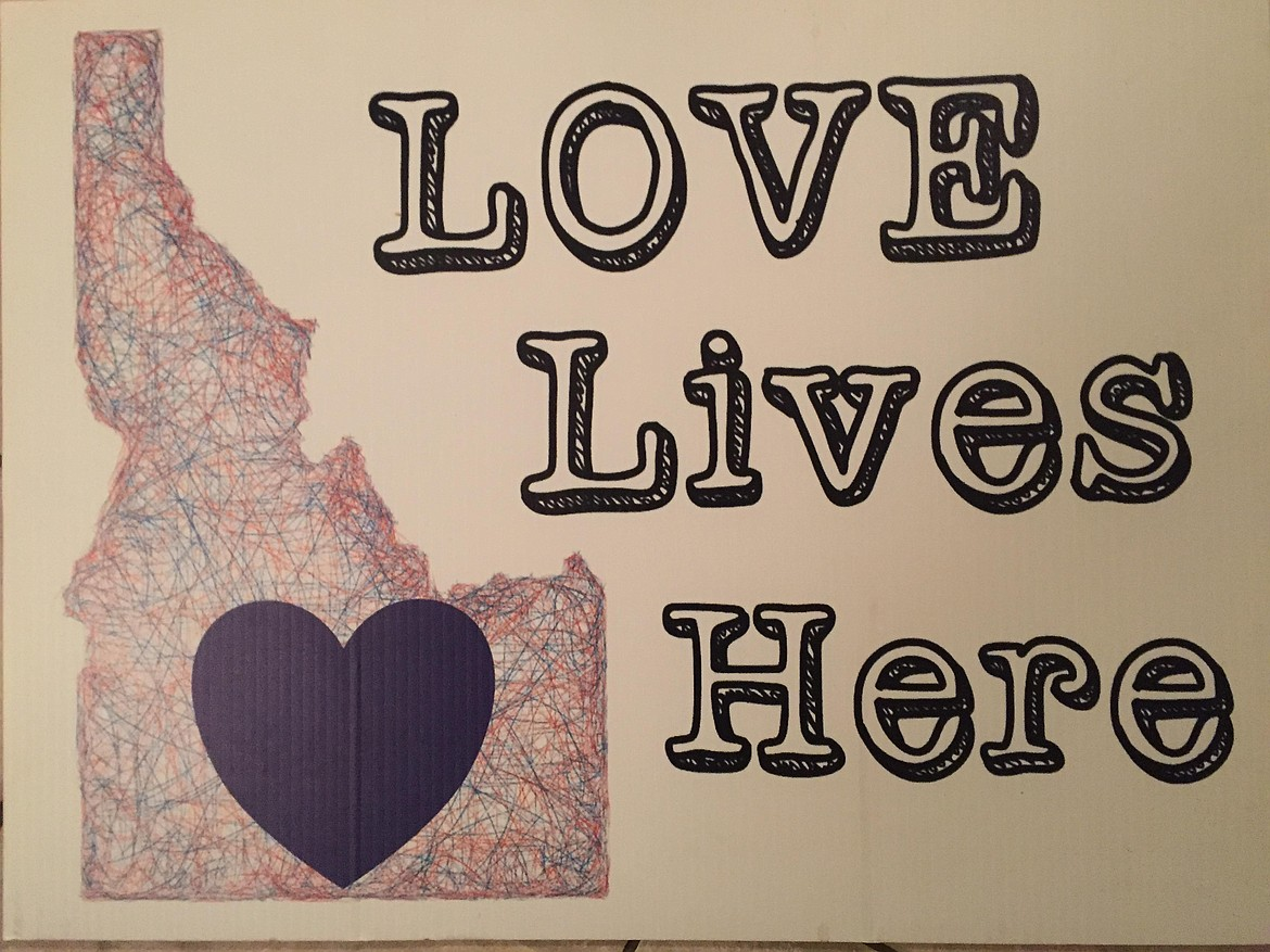 A Love Lives Here sign available as part of the Love Lives Here campaign.