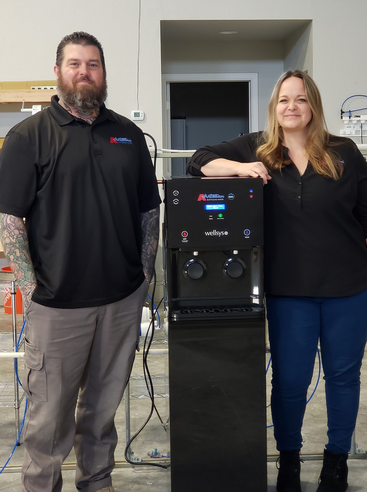 Courtesy photo Artesian Bottleless Water's Leigh and Nick Willis pose inside their new store in Unit B at 6255 W. Integrity Way (behind Walmart and next to California Closets) in Post Falls.