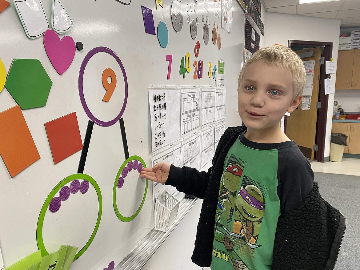 """Betty Kiefer Elementary School kindergartener Gunnar Pursley works on his number bonds by playing with what he calls """"aliens"""" on planet Earth and Mars. (Madison Hardy/Press)"""