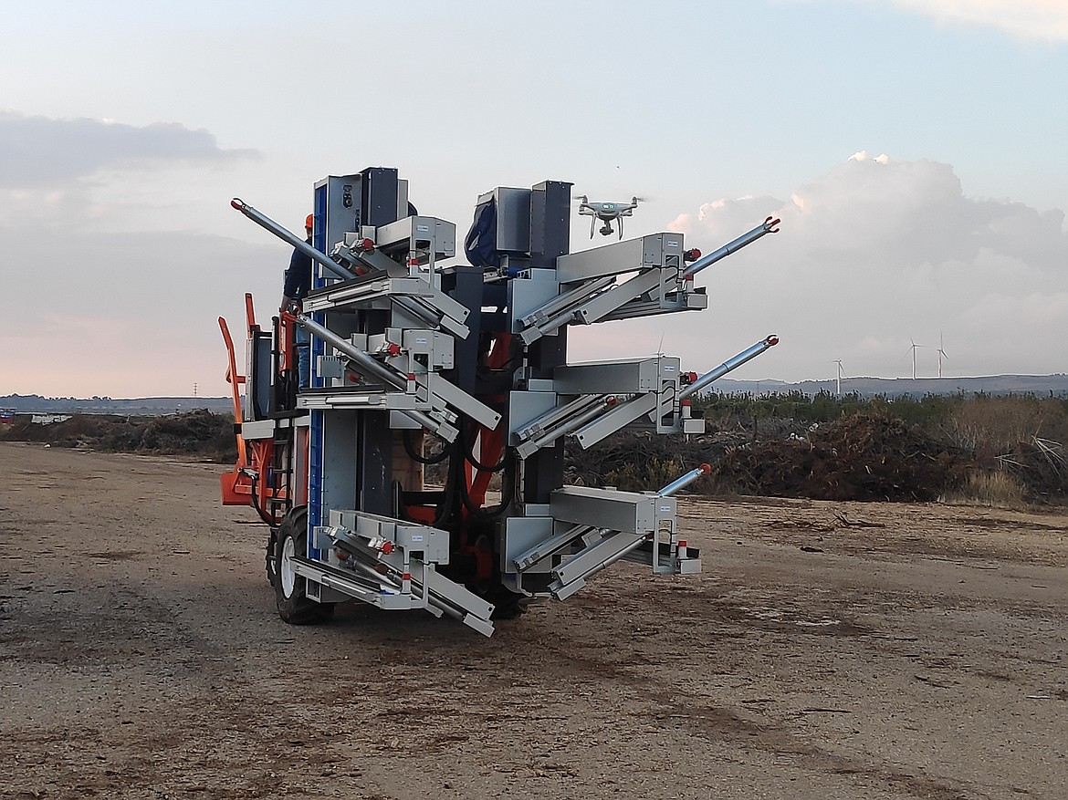 The FFRobotics' automated harvesting machine on its way to work.