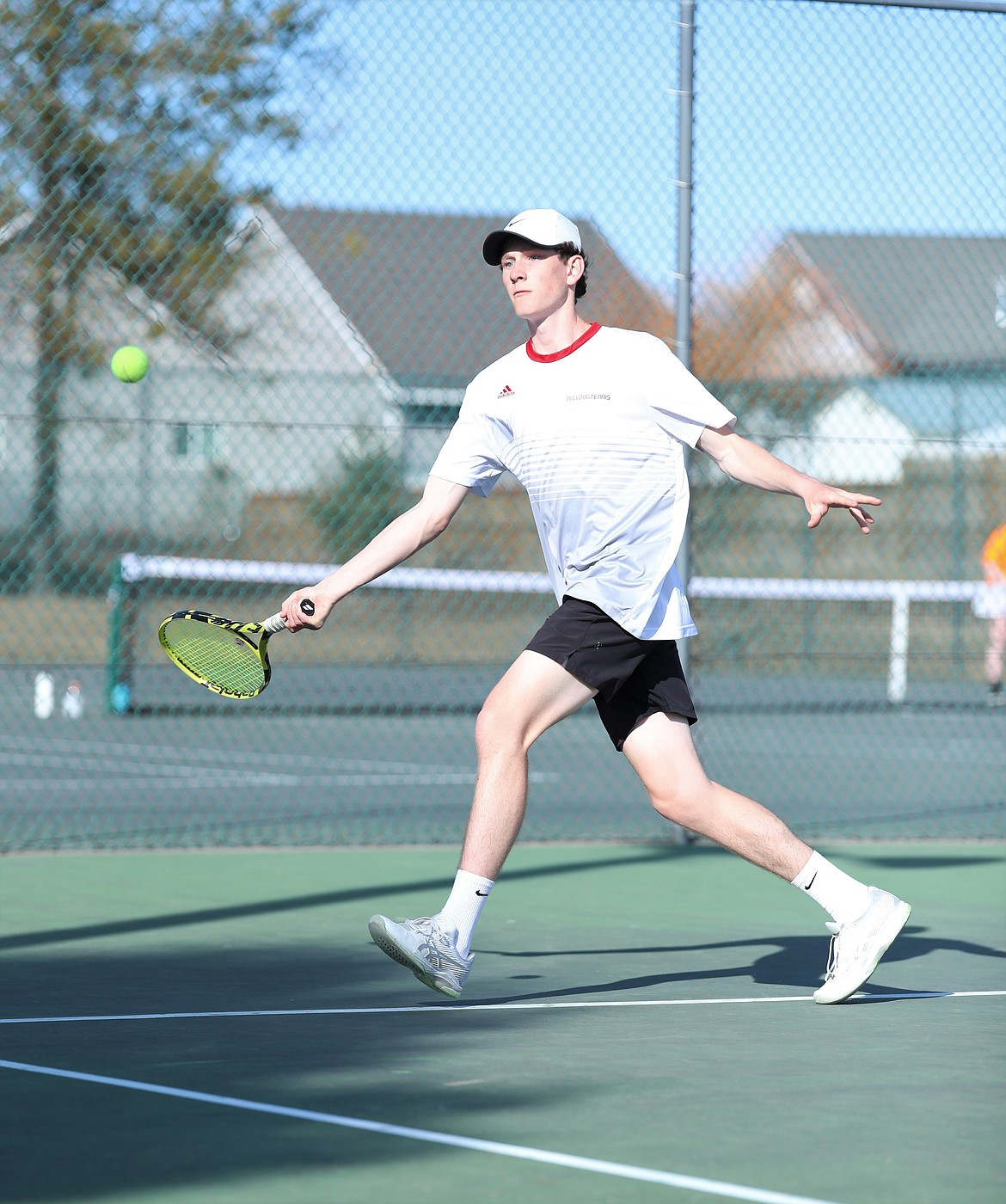 Josh Embree chases down the ball and hits a forehand on Wednesday.