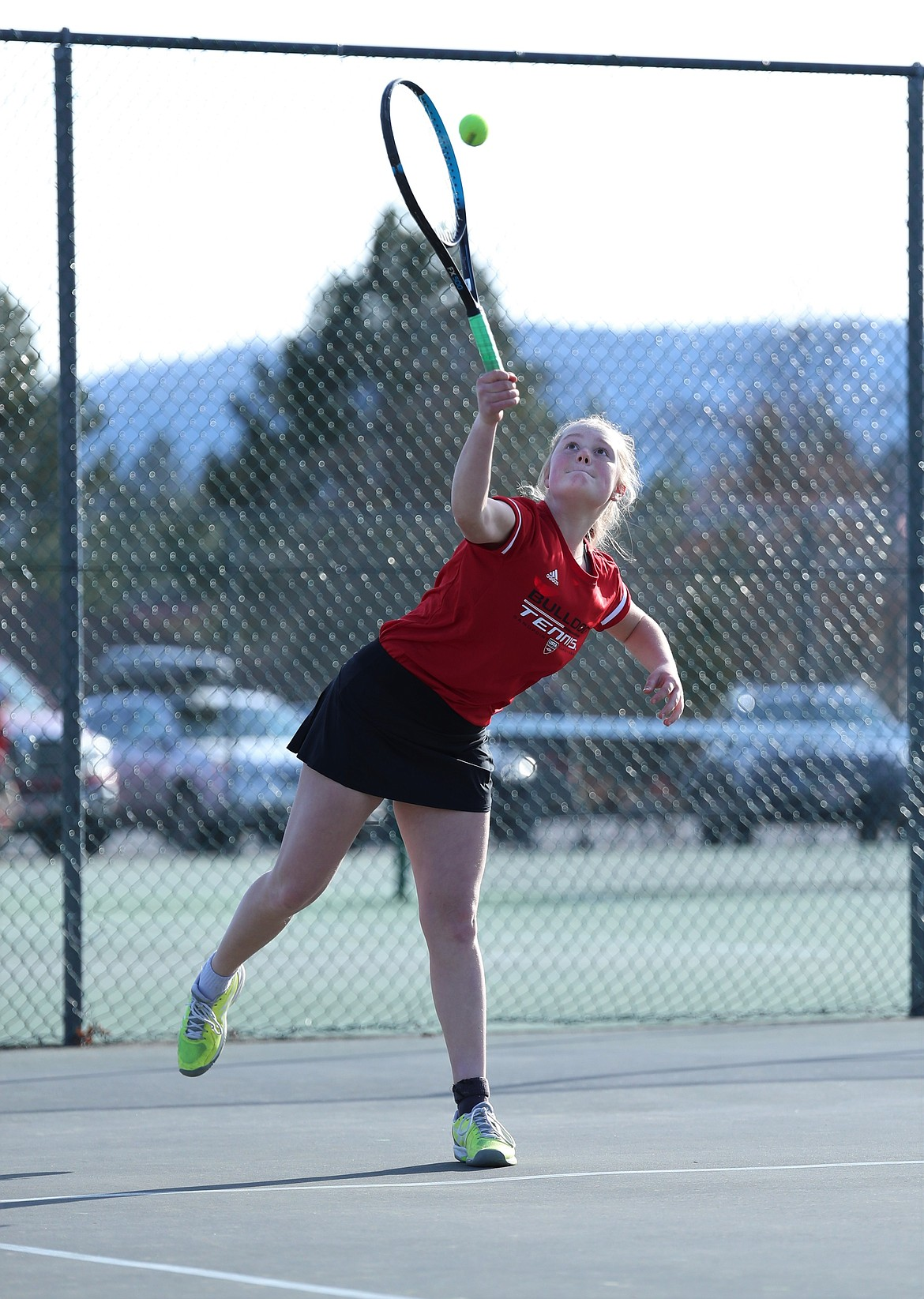 Berkeley Cox serves during doubles play on Wednesday.