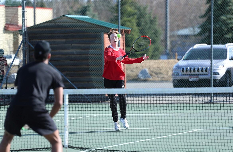 Charlie Johnson attacks the net Wednesday.