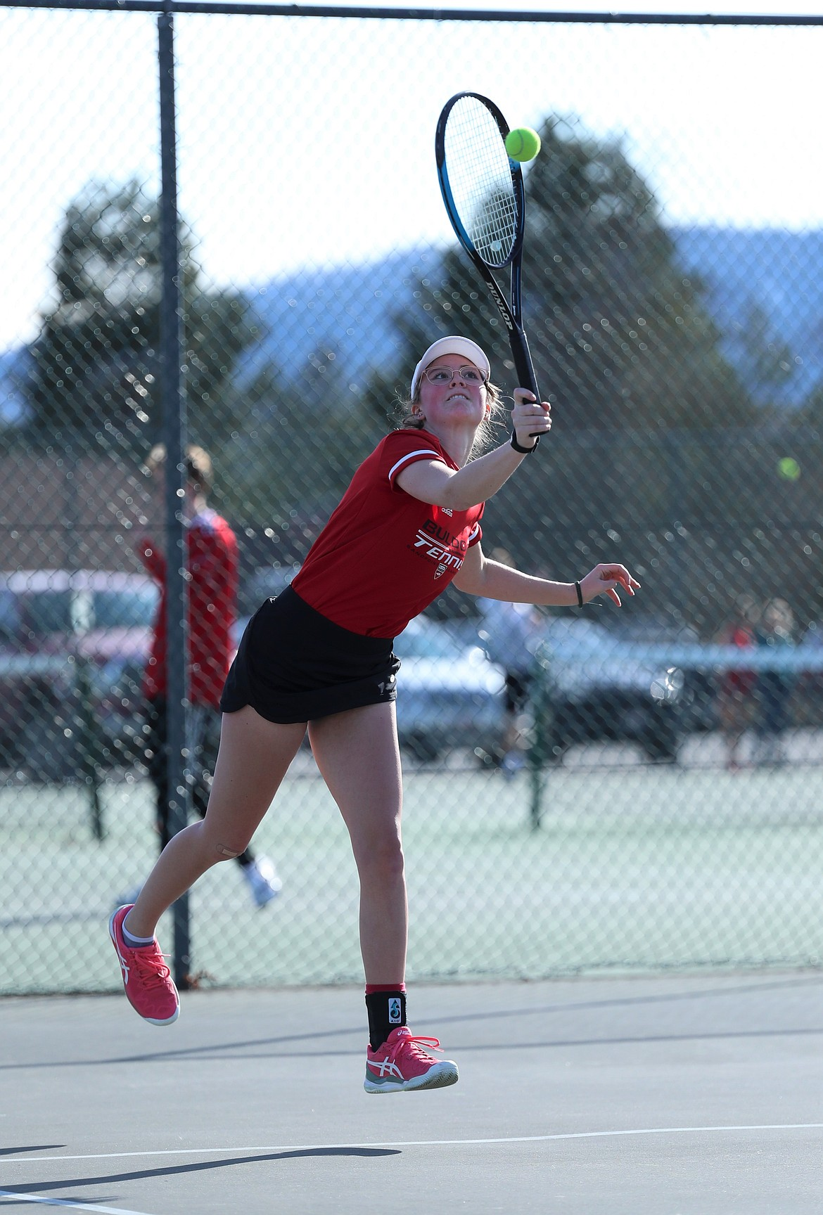 Junior Denali Terry serves during doubles play on Wednesday at Travers Park.
