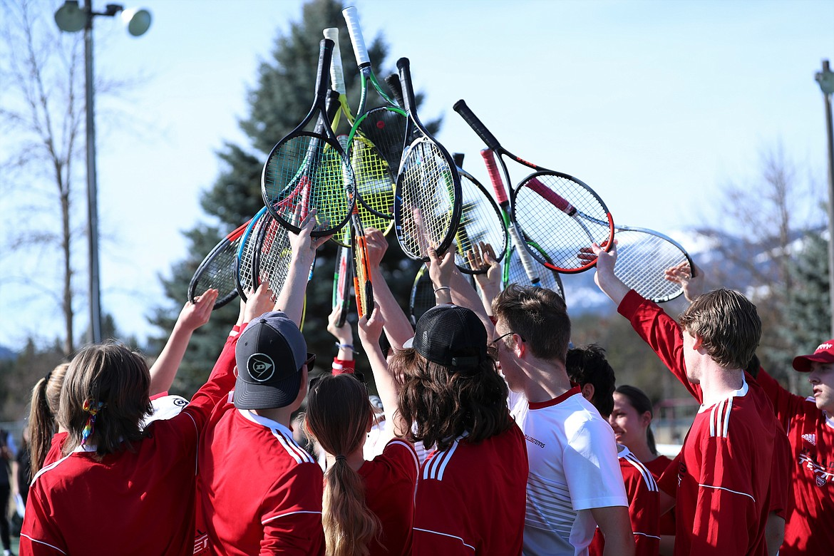 The Sandpoint tennis team huddles up prior to Wednesday's match against Post Falls.