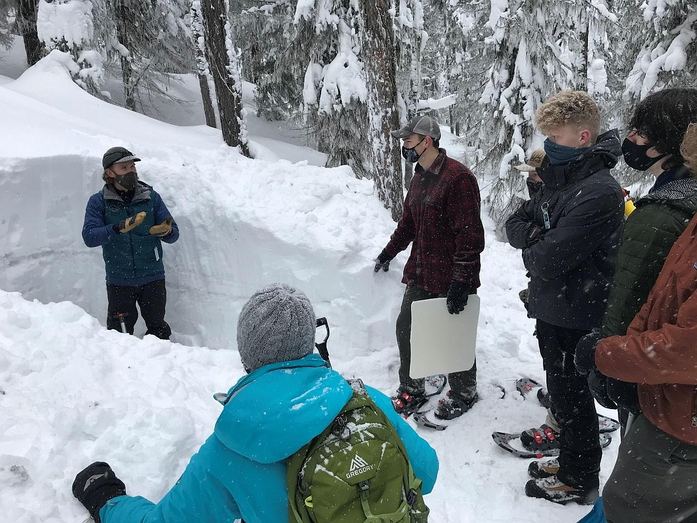 Lake City teacher Jamie Esler gives an avalanche safety demonstration.