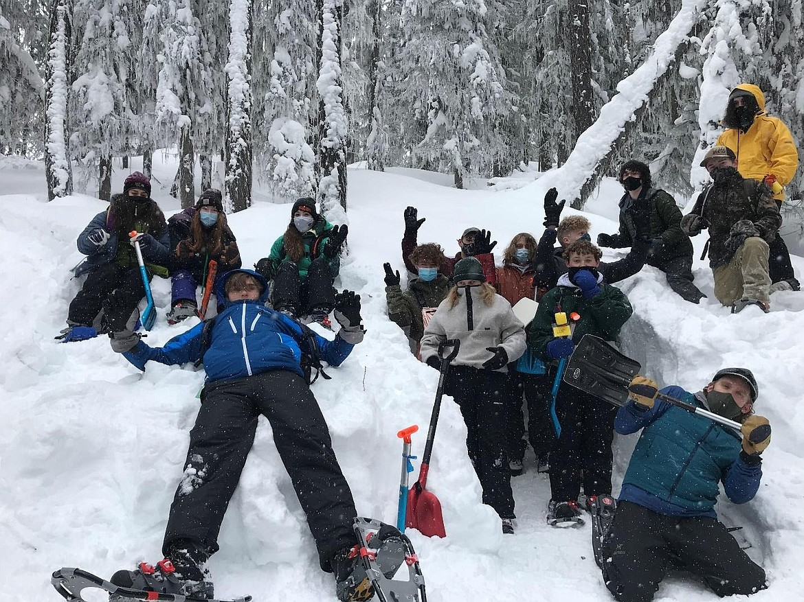 Students celebrate finishing their snowpack measurements.