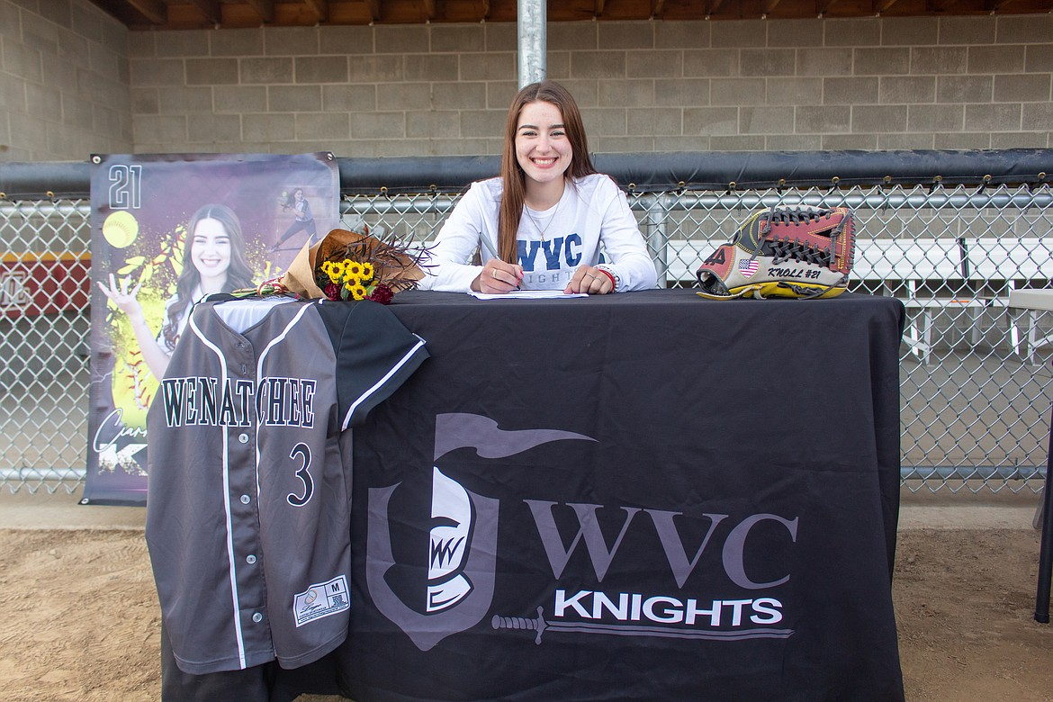 Moses Lake's Ciarrah Knoll smiles as she signs to play next softball next season at Wenatchee Valley College on Wednesday afternoon at Moses Lake High School.