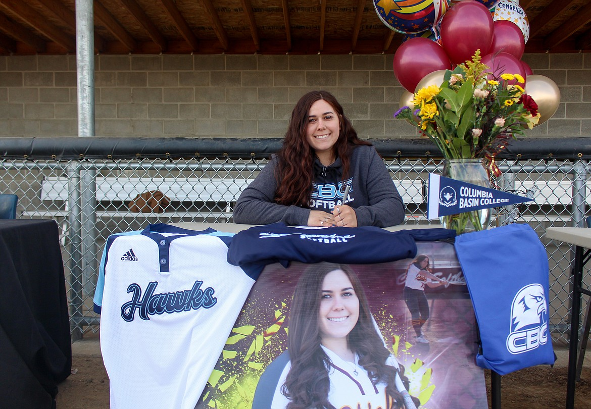 Moses Lake's Harley Raymond signed to play for Columbia Basin College on Wednesday afternoon at Moses Lake High School beside future/current teammate Madi Olson.