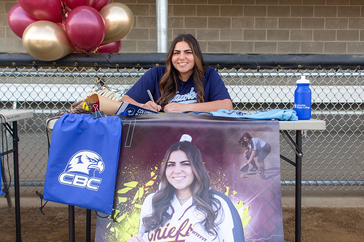 Moses Lake senior Madi Olson secured another two years of softball on Wednesday afternoon as she signed to play next fall at Columbia Basin College at MLHS.