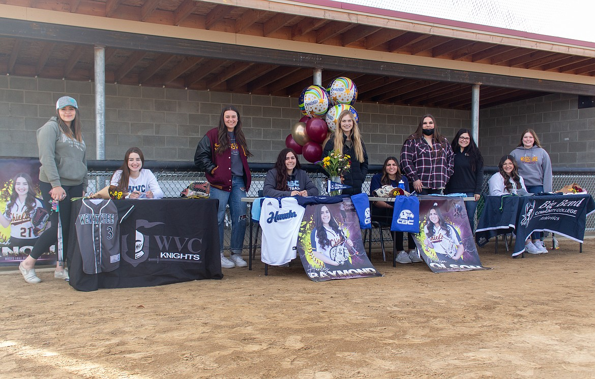 Seated left to right, Ciarrah Knoll, Harley Raymond, Madi Olson and Laurissa Martinez were joined by teammates and family to help celebrate their signings on Wednesday afternoon at MLHS.