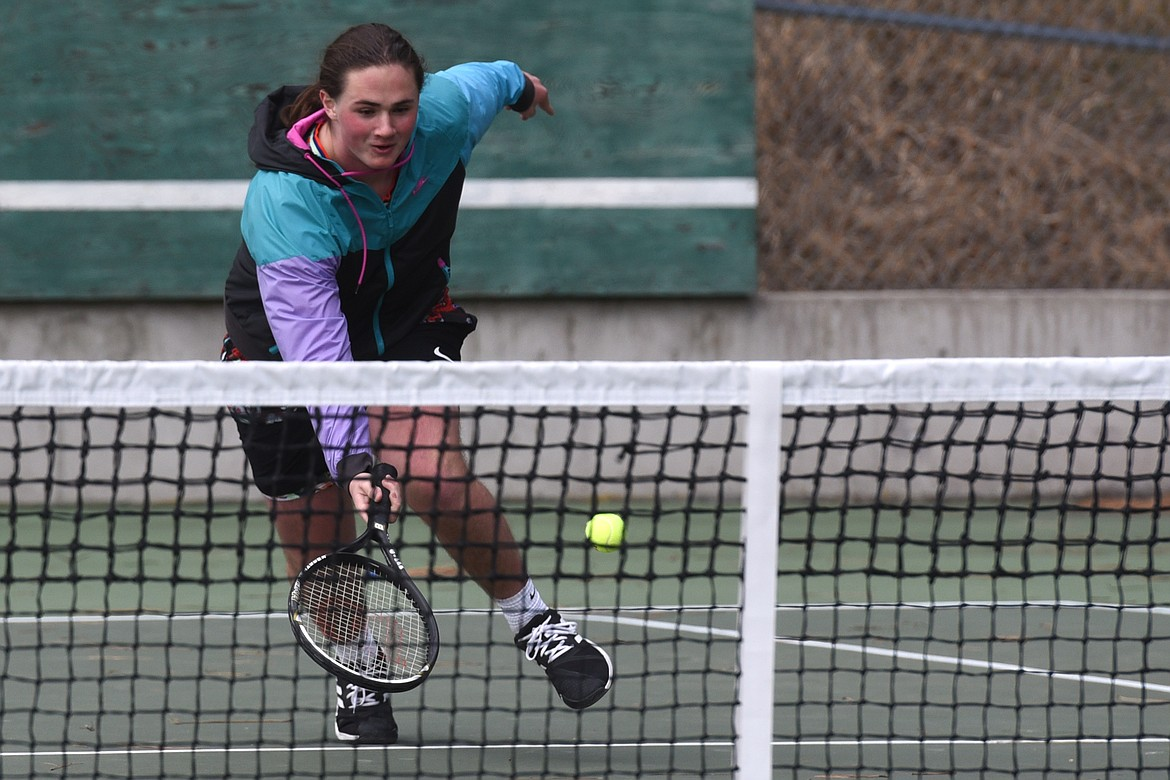 Andrew Porrovecchio makes a lunge for the ball during Vikings tennis practice Monday afternoon. Jeremy Weber/Bigfork Eagle
