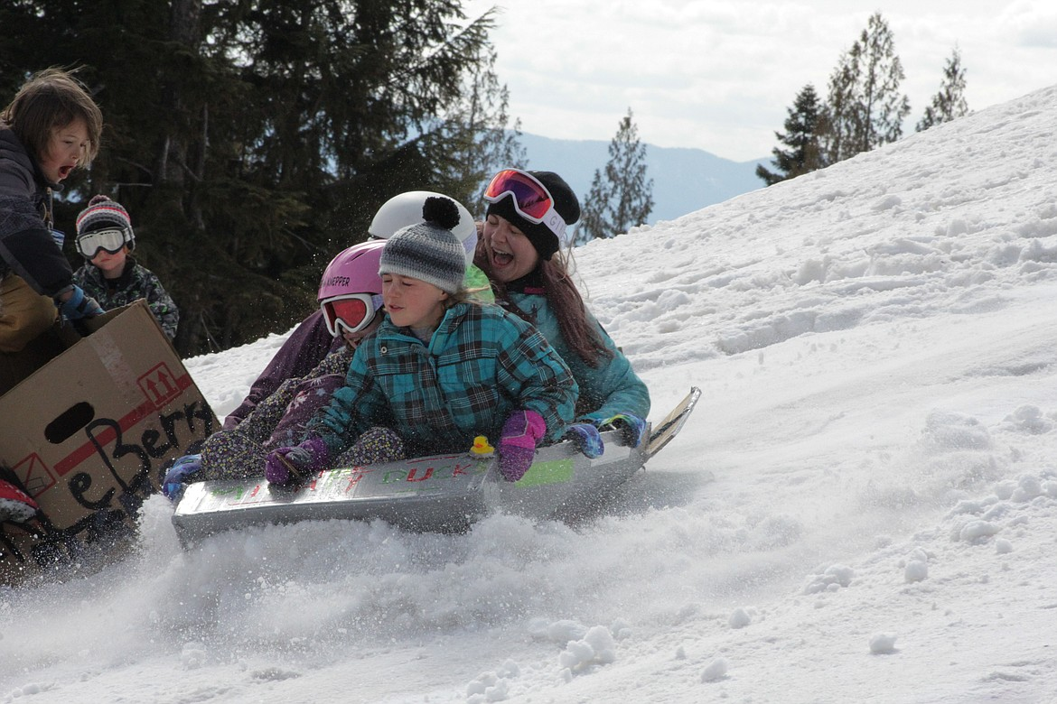 Annemarie, Morrison, Mikaia and Halo sled at Schweitzer mountain Tuesday morning.