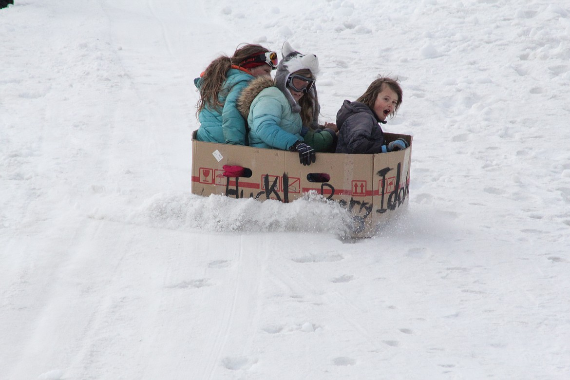 Morrison, Shawnee and Caylee slide down the hill Tuesday morning at Schweitzer.