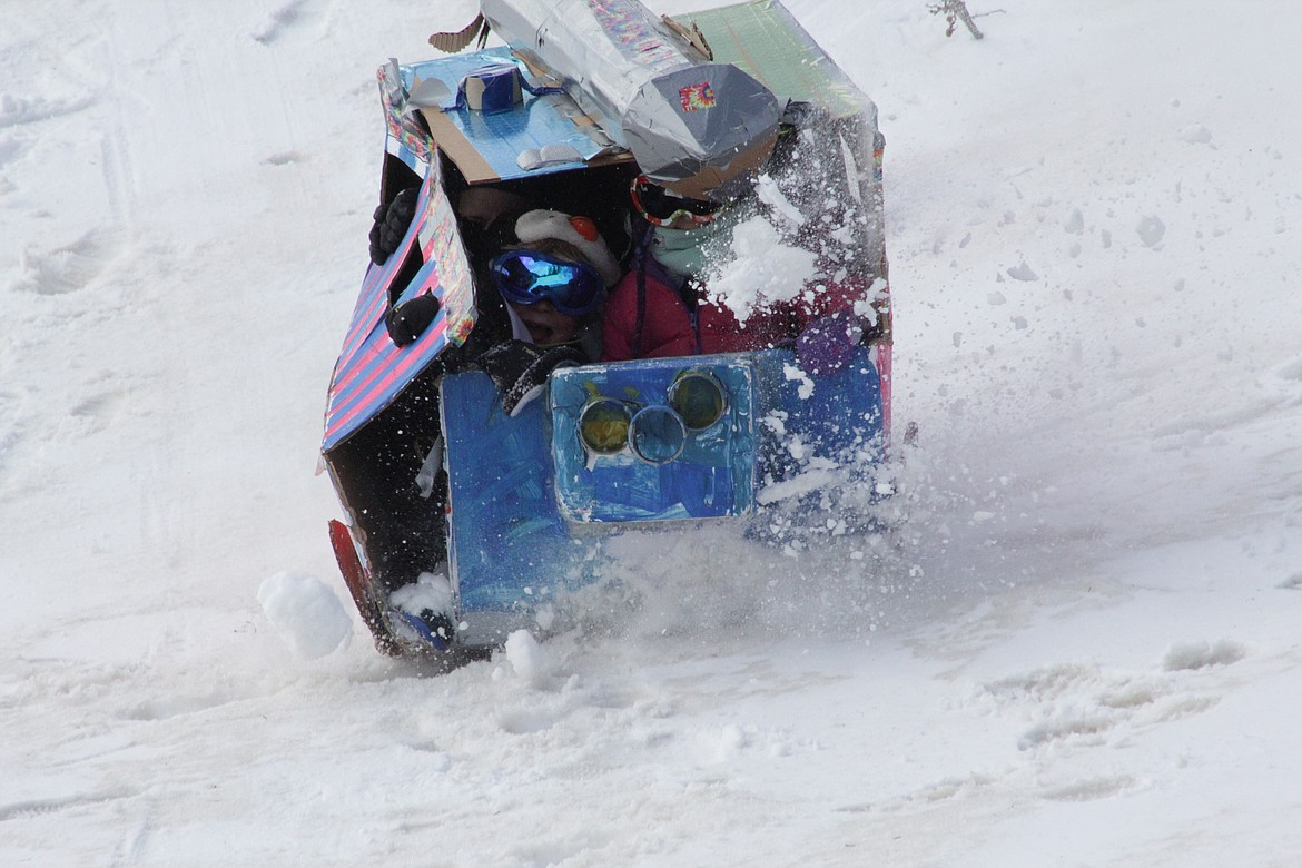 Toboggans are slowly demolished with each run as students at the Homeschool Academy slide down the hill at Schweitzer Tuesday morning.