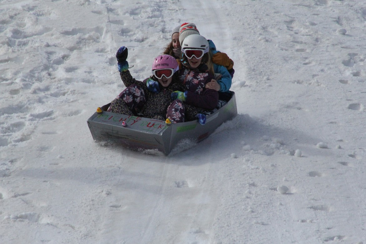 Brooklyn, Makia and Xadrian slide down the hill at Schweitzer Tuesday morning.