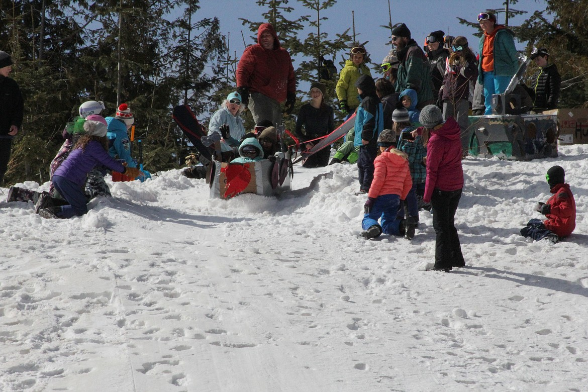 Students push off in their toboggan Tuesday morning at Schweitzer.