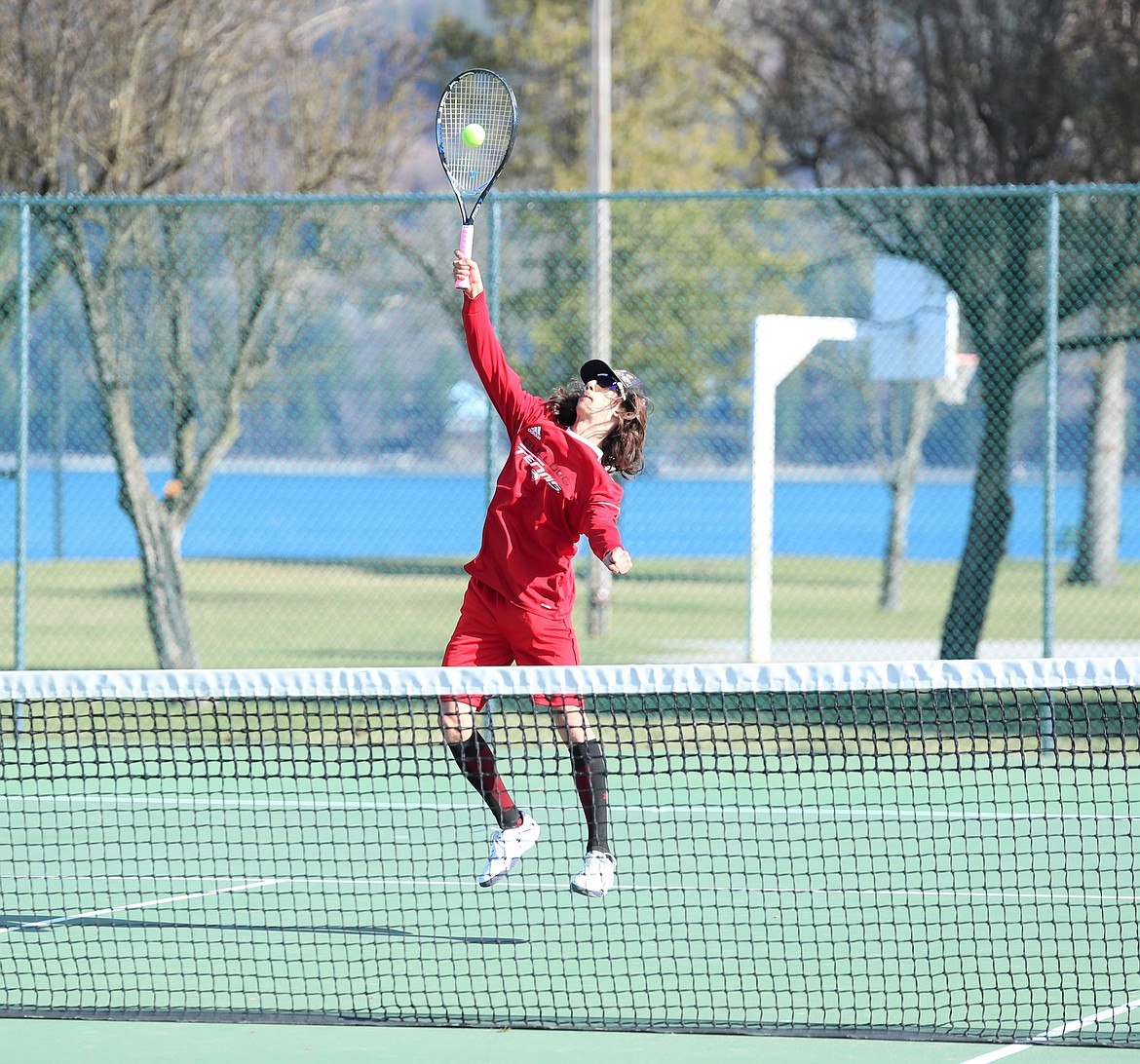 Aden Heitz hits a volley on Wednesday.