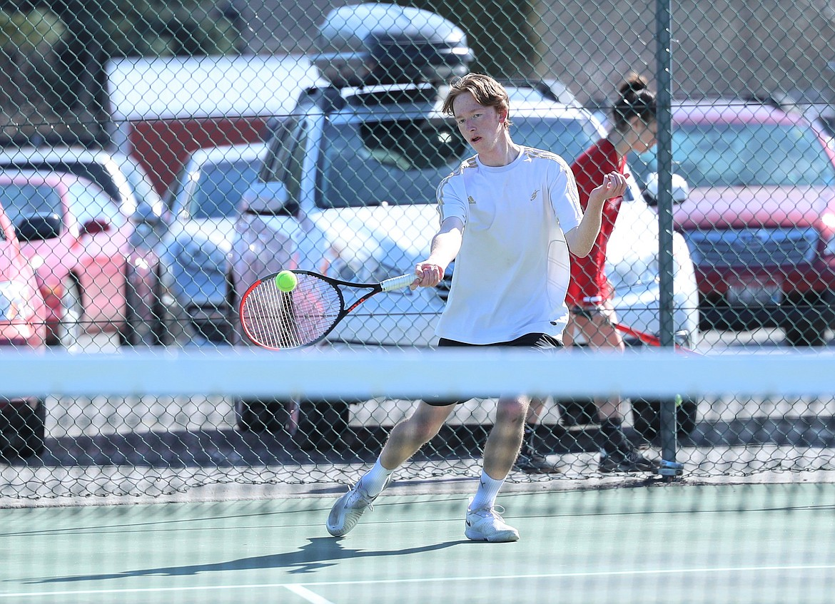 Charlie Johnson hits a forehand on Wednesday.