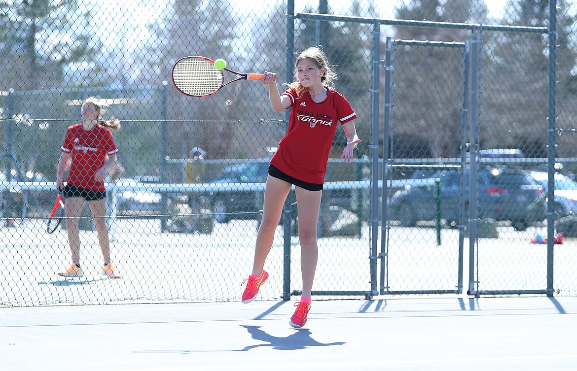 Maile Evans elevates to hit a forehand on Wednesday.