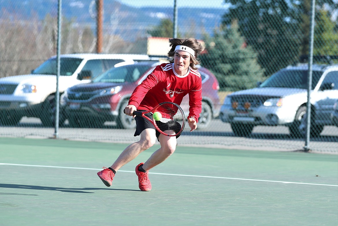 Tyler McNamee gets down low to return a backhand in singles play on Wednesday.