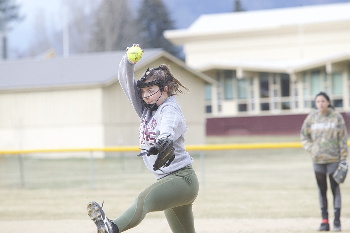 Jaylee Leighty winds up for pitch during a March 26 Troy softball practice. (Will Langhorne/The Western News)