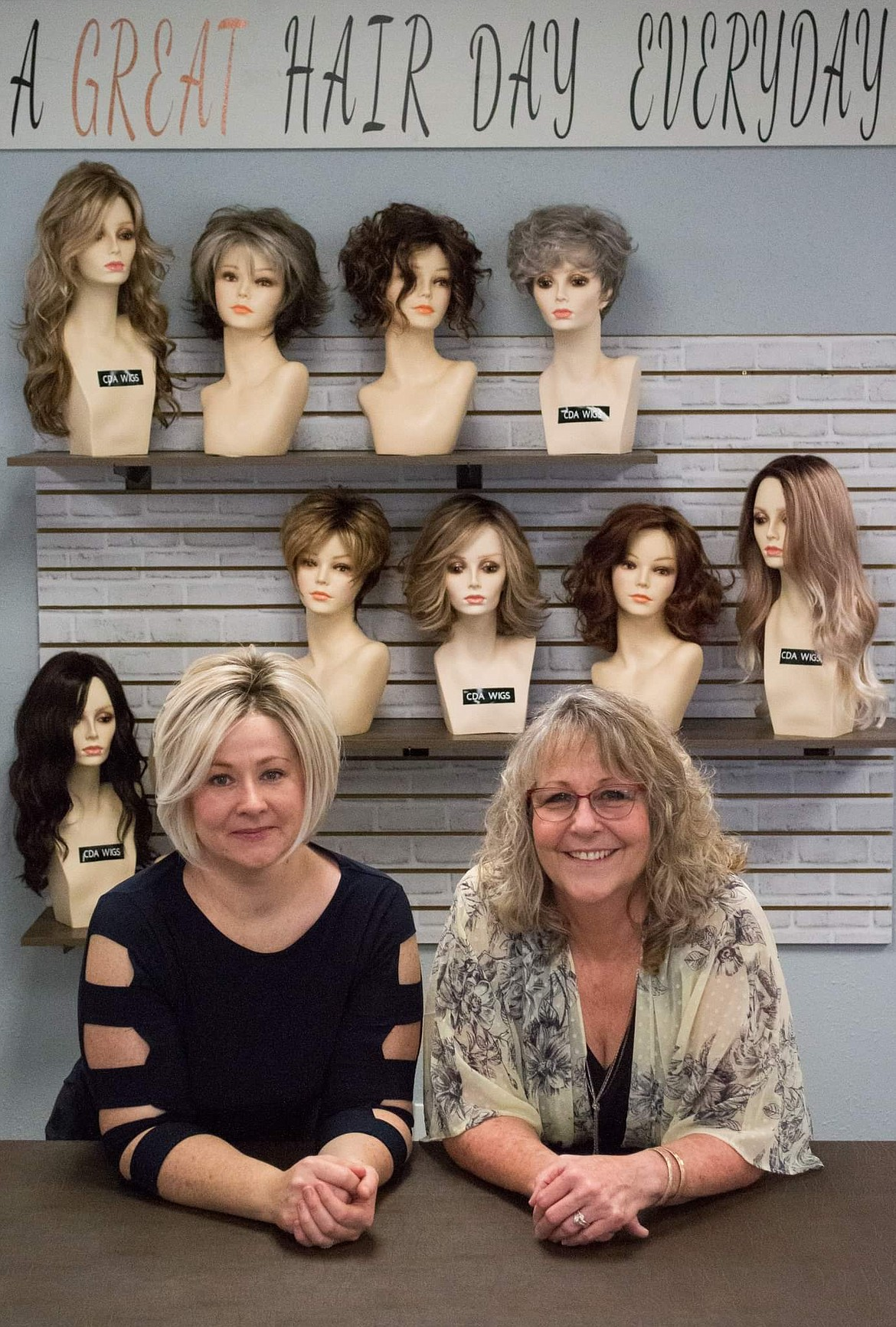 Courtesy photo Jennifer Lindley and Sandy Swinyer, owners of Coeur d'Alene Wigs, are seen at their business in Suite 17 of Sunset Village (off U.S. 95).