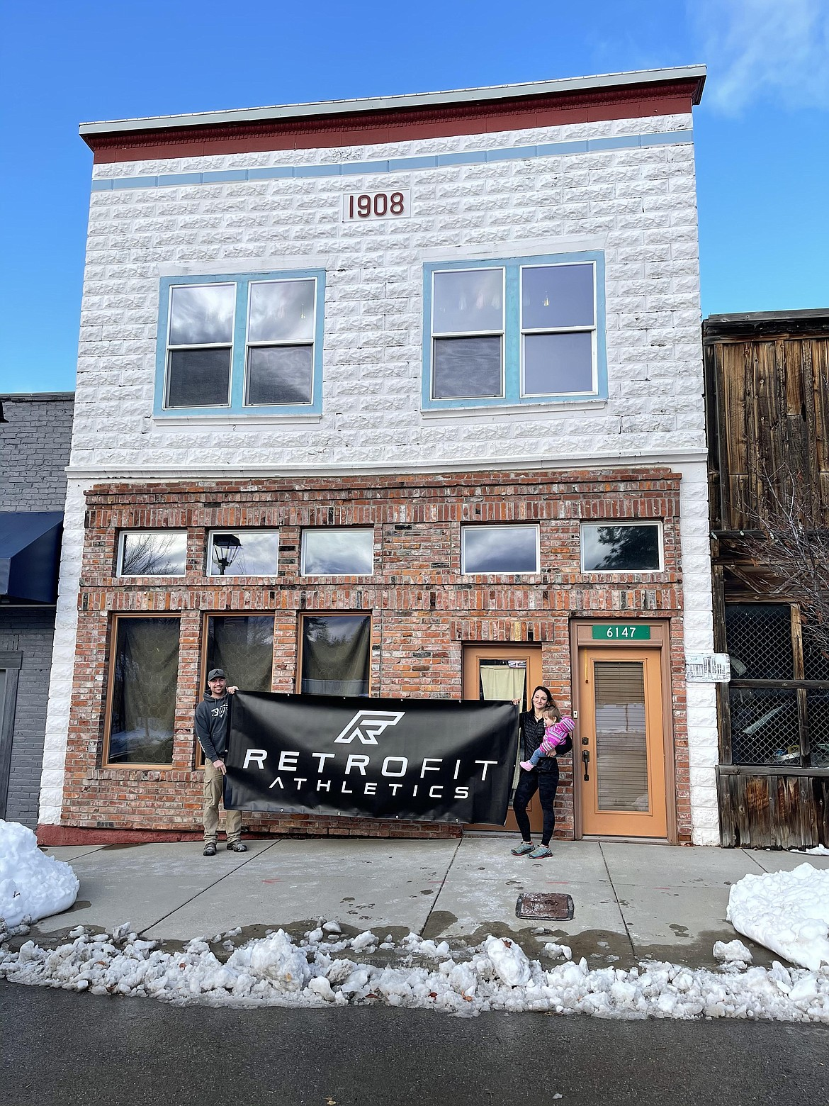 Courtesy photo Tyler and Meghan Mitchell (with daughter Blakely) of Retrofit Athletics, which has opened at 6147 W. Maine St. in Spirit Lake.