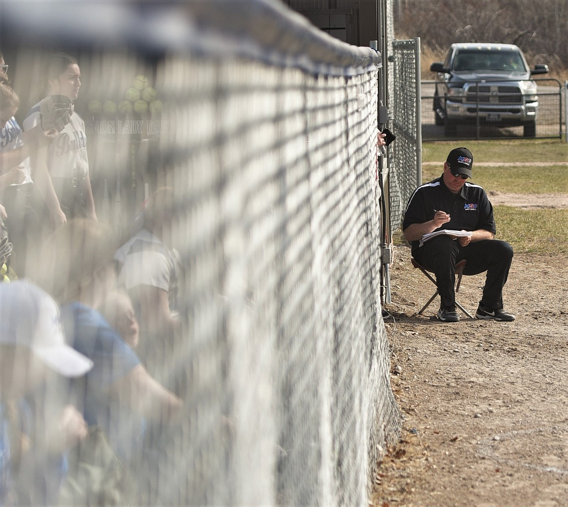 Mission-Arlee-Charlo coach Shane Reum checks his notes during his team's game against Eureka. (Scot Heisel/Lake County Leader)