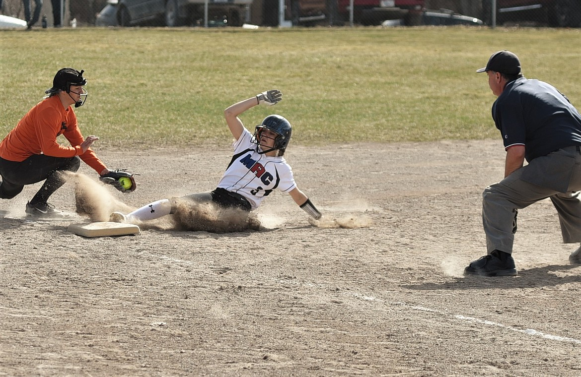Jerny Crawford slides safely into third against Eureka. (Scot Heisel/Lake County Leader)
