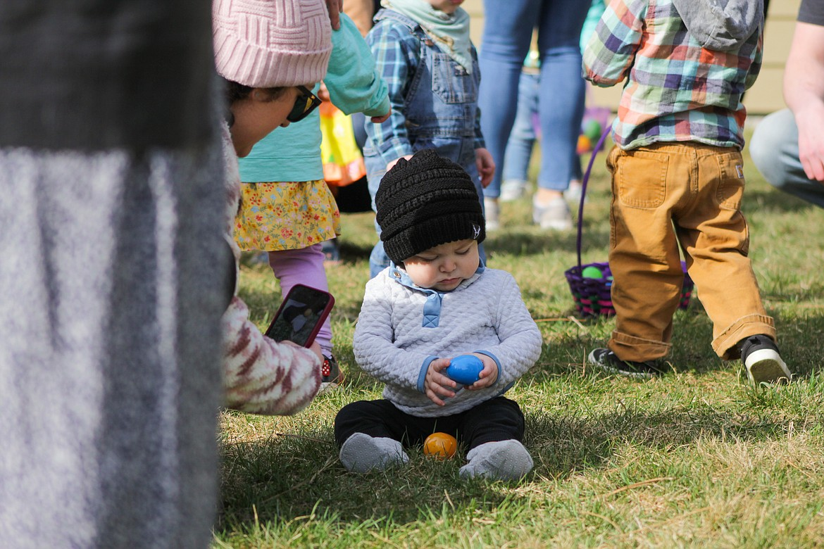 A child holds an egg he picked up Saturday at the egg hunt.