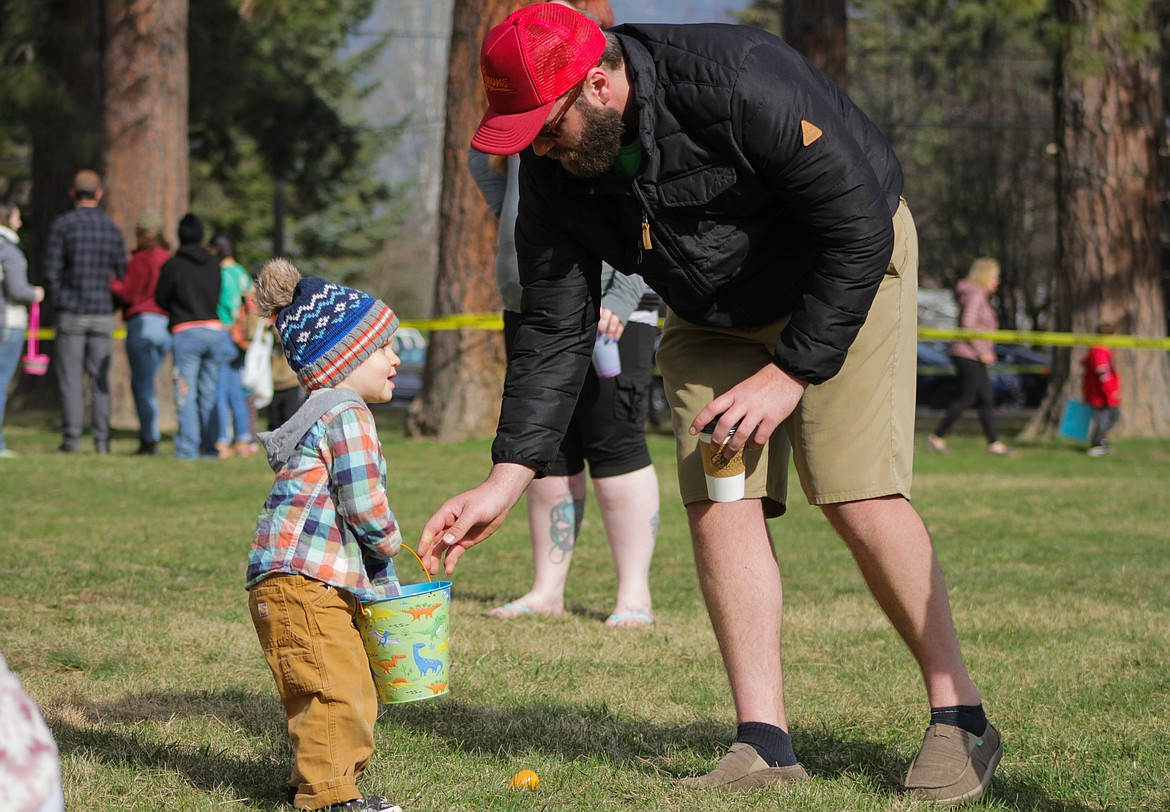 A father helps his son with the egg hunt Saturday at Lakeview Park.
